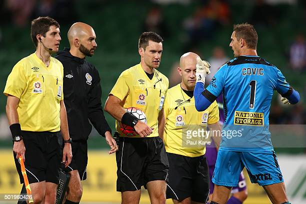 Ante Covic of the Glory questions Referee Jarred Gillett as players and officials walk from the field at the half time break during the round 11...