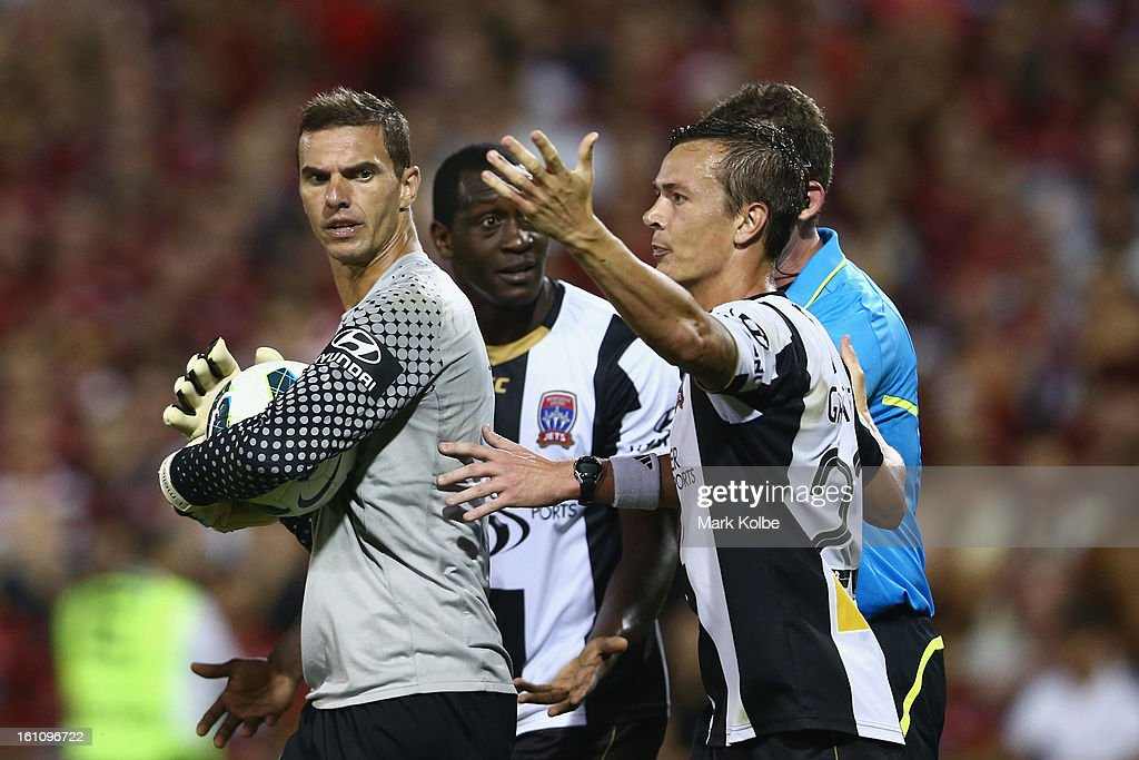 Ante Covic of the Wanderers exchanges heated words with Emile Heskey and Ryan Griffiths of the Jets as he holds the ball to wind down the clock after a Jets goal during the round 20 A-League match between the Western Sydney Wanderers and the Newcastle Jets at Campbelltown Sports Stadium on February 9, 2013 in Sydney, Australia.