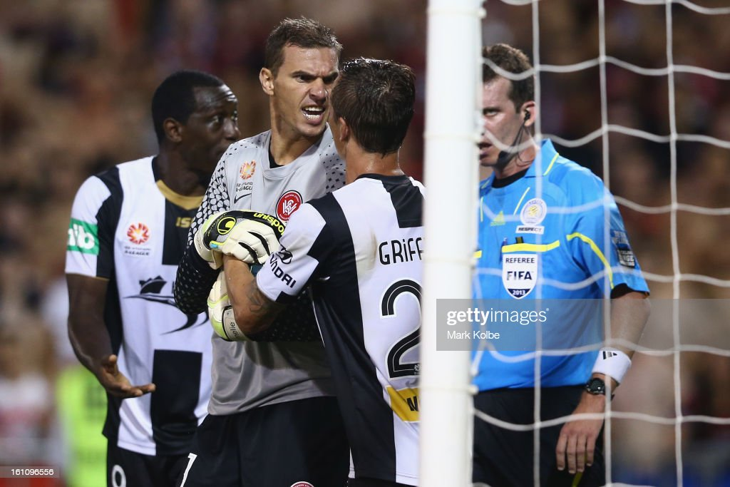Ante Covic of the Wanderers exchanges heated words with Ryan Griffiths of the Jets as he holds the ball to wind down the clock after during the round 20 A-League match between the Western Sydney Wanderers and the Newcastle Jets at Campbelltown Sports Stadium on February 9, 2013 in Sydney, Australia.