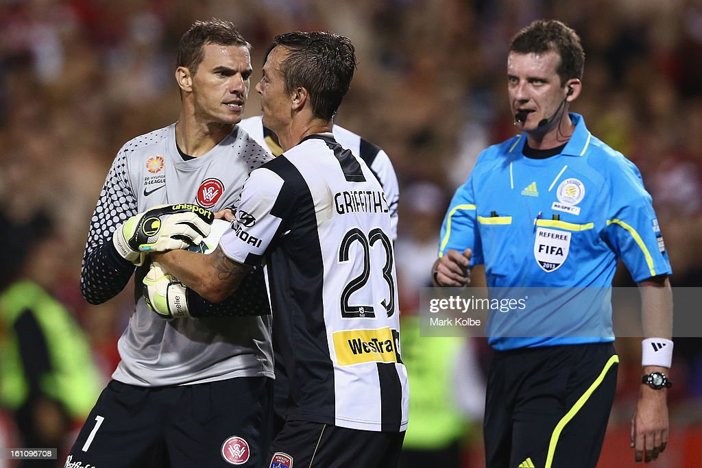 Ante Covic of the Wanderers exchanges heated words with Ryan Griffiths of the Jets as he holds the ball to wind down the clock after a Jets goal during the round 20 A-League match between the Western Sydney Wanderers and the Newcastle Jets at Campbelltown Sports Stadium on February 9, 2013 in Sydney, Australia.