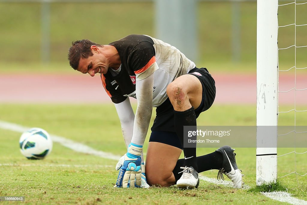 Ante Covic of the Wanderers grimaces after falling awkwardly during a Western Sydney Wanderers A-League training session at Blacktown International Sportspark on April 16, 2013 in Sydney, Australia.