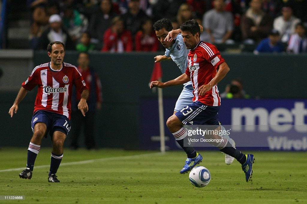Ante Jazic of Chivas USA and Omar Bravo of Sporting Kansas City vie for the ball during the MLS match at The Home Depot Center on March 19 2011 in...