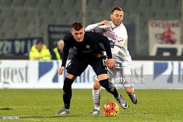 Ante Rebic of ACF Fiorentina battles for the ball with Antonio Di Gaudio of Carpi Fc during the TIM Cup match between ACF Fiorentina and Carpi FC at...
