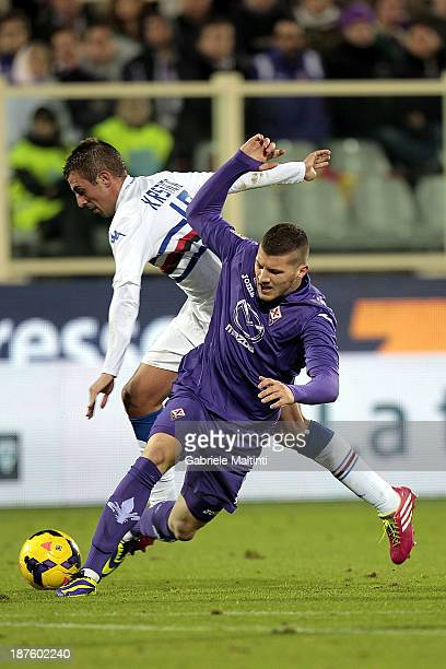 Ante Rebic of ACF Fiorentina fights for the ball with Nenad Krsticic of UC Sampdoria during the Serie A match between ACF Fiorentina and UC Sampdoria...
