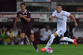 Ante Rebic of ACF Fiorentina in action against Danilo Avelar of Torino FC during the Serie A match between Torino FC and ACF Fiorentina at Stadio...