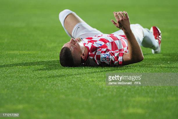 Ante Rebic of Croatia lays injured during the FIFA U20 World Cup Group F match between Uruguay and Croatia at the Ataturk Stadium on June 23 2013 in...