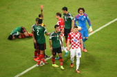 Ante Rebic of Croatia walks off the pitch after receiving a red card during the 2014 FIFA World Cup Brazil Group A match between Croatia and Mexico...