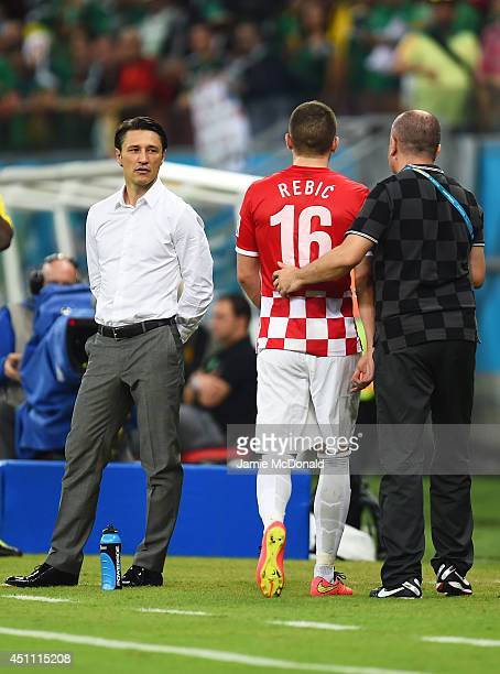 Ante Rebic of Croatia walks off the pitch after receiving a red card as head coach Niko Kovac looks on during the 2014 FIFA World Cup Brazil Group A...