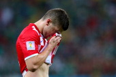 Ante Rebic of Croatia walks off the pitch as he receives a red card during the 2014 FIFA World Cup Brazil Group A match between Croatia and Mexico at...
