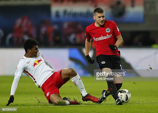 Ante Rebic of Eintracht Frankfurt is challenged by Bernardo of RB Leipzig during the Bundesliga match between RB Leipzig and Eintracht Frankfurt at...