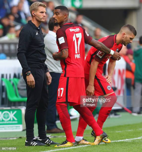 Ante Rebic of Frankfurt and KevinPrince Boateng looks on during the Bundesliga match between Borussia Moenchengladbach and Eintracht Frankfurt at...