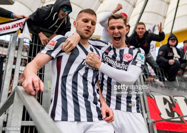 Ante Rebic of Frankfurt celebrates the third goal for his team with Guillermo Varela of Frankfurt during the Bundesliga match between Eintracht...