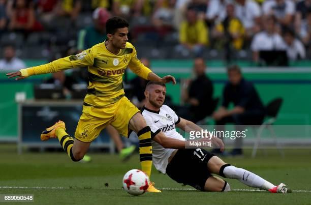 Ante Rebic of Frankfurt challenges Marc Bartra of Dortmund during the DFB Cup final match between Eintracht Frankfurt and Borussia Dortmund at...