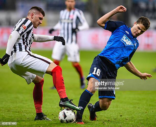 Ante Rebic of Frankfurt challenges Pirmin Schwegler of Hoffenheim during the Bundesliga match between Eintracht Frankfurt and TSG 1899 Hoffenheim at...