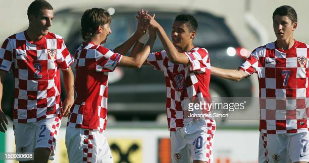Ante Roguljic of Croatia celebrates with his team mates after coring his team's third goal during the international UEFA Toto Cup 2012 match between...