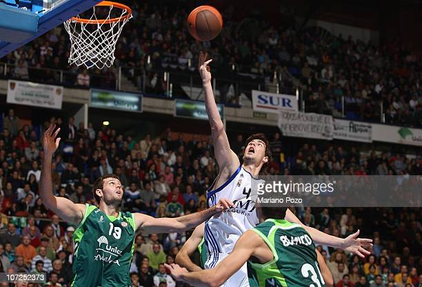 Ante Tomic #4 of Real Madrid in action during the 20102011 Turkish Airlines Euroleague Regular Season Date 7 game between Unicaja vs Real Madrid at...