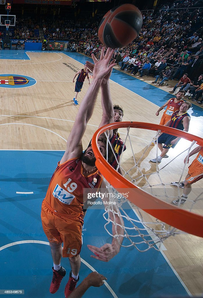 Ante Tomic, #44 of FC Barcelona competes with <a gi-track='captionPersonalityLinkClicked' href=/galleries/search?phrase=Furkan+Aldemir&family=editorial&specificpeople=8056755 ng-click='$event.stopPropagation()'>Furkan Aldemir</a>, #19 of Galatasaray Liv Hospital Istanbul during the Turkish Airlines Euroleague Basketball Play Off Game 2 between FC Barcelona Regal v Galatasaray Liv Hospital Istanbul at Palau Blaugrana on April 17, 2014 in Barcelona, Spain.