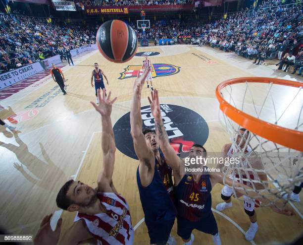 Ante Tomic #44 of FC Barcelona Lassa and Adrien Moerman #45 competes with Ioannis Papapetrou #6 of Olympiacos Piraeus during the 2017/2018 Turkish...