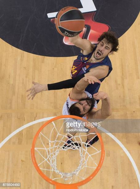 Ante Tomic #44 of FC Barcelona Lassa competes with Bojan Dubljevic #14 of Valencia Basket during the 2017/2018 Turkish Airlines EuroLeague Regular...