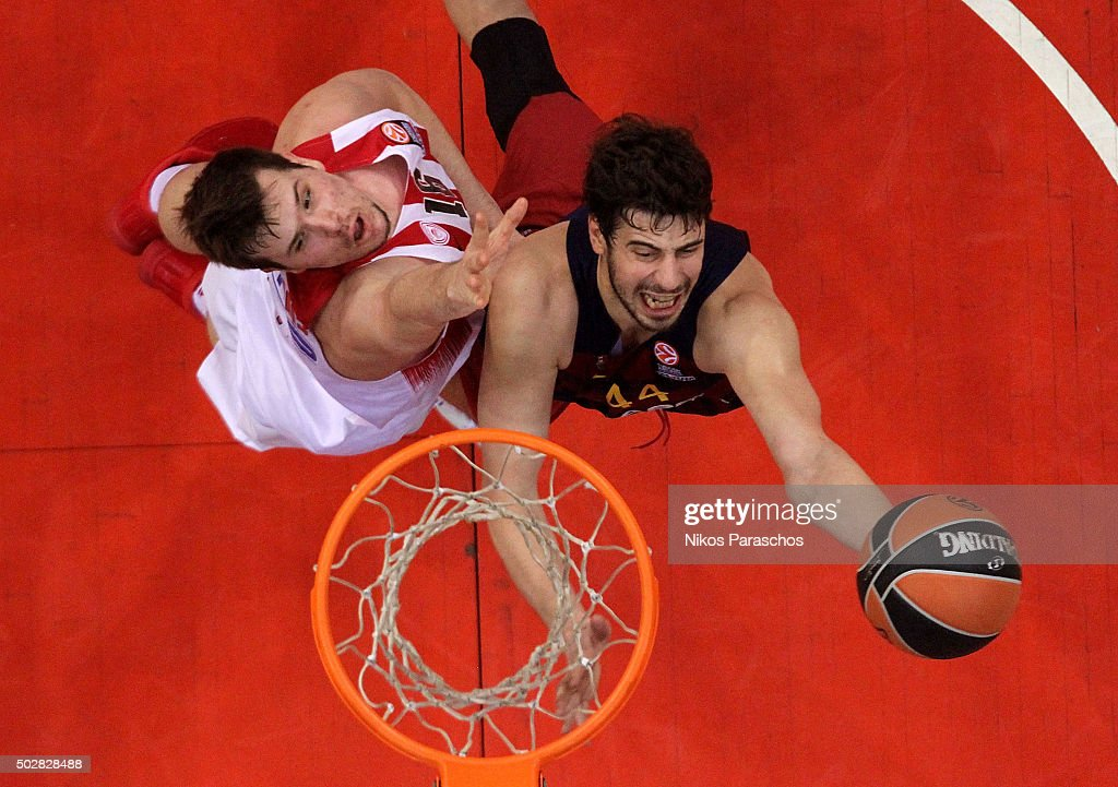 Ante Tomic, #44 of FC Barcelona Lassa competes with Dimitrios Agravanis, #16 of Olympiacos Piraeus during the Turkish Airlines Euroleague Basketball Top 16 Round 1 game between Olympiacos Piraeus v FC Barcelona Lassa at Peace and Friendship Stadium on December 29, 2015 in Athens, Greece.