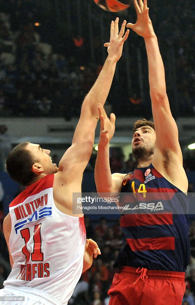 Ante Tomic, #44 of FC Barcelona Lassa competes with <a gi-track='captionPersonalityLinkClicked' href=/galleries/search?phrase=Nikola+Milutinov&family=editorial&specificpeople=9965777 ng-click='$event.stopPropagation()'>Nikola Milutinov</a>, #11 of Olympiacos Piraeus during the Turkish Airlines Euroleague Basketball Top 16 Round 1 game between Olympiacos Piraeus v FC Barcelona Lassa at Peace and Friendship Stadium on December 29, 2015 in Athens, Greece.