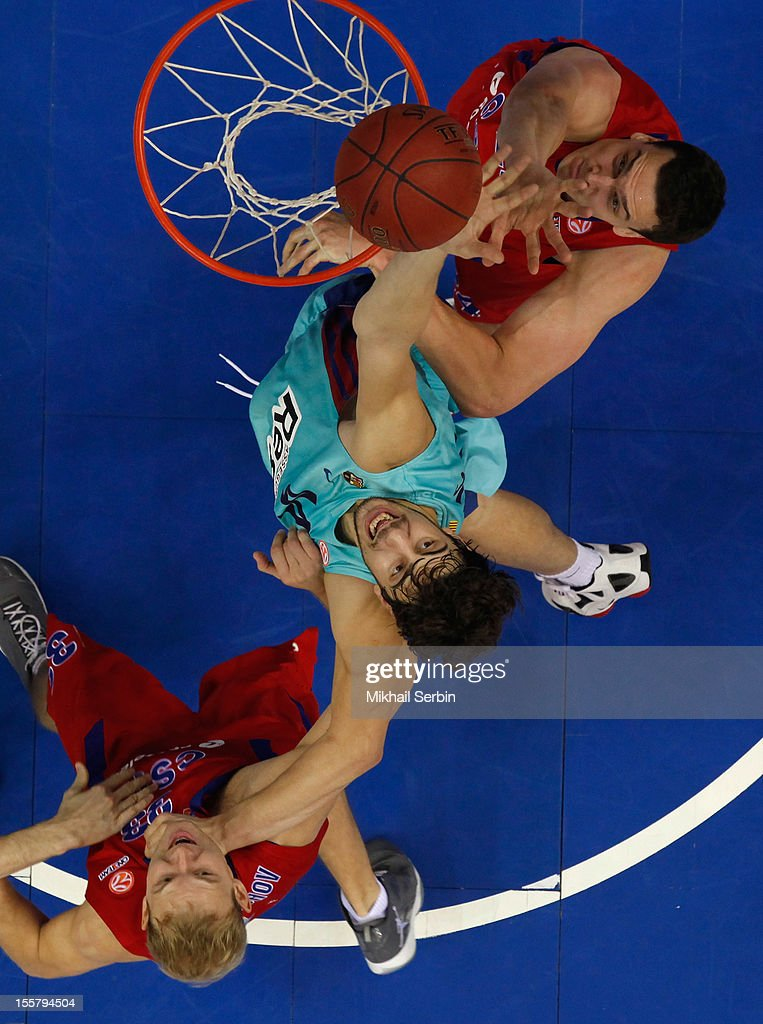 Ante Tomic, #44 of FC Barcelona Regal competes with <a gi-track='captionPersonalityLinkClicked' href=/galleries/search?phrase=Sasha+Kaun&family=editorial&specificpeople=802084 ng-click='$event.stopPropagation()'>Sasha Kaun</a>, #24 and <a gi-track='captionPersonalityLinkClicked' href=/galleries/search?phrase=Anton+Ponkrashov&family=editorial&specificpeople=2145662 ng-click='$event.stopPropagation()'>Anton Ponkrashov</a>, #33 of CSKA Moscow in action during the 2012-2013 Turkish Airlines Euroleague Regular Season Game Day 5 between CSKA Moscow v FC Barcelona Regal at A. Gomelsky Universal Sports Hall on November 8, 2012 in Moscow, Russia.