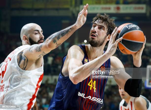 Ante Tomic of Barcelona in action against Pero Antic of Crvena Zvezda during the 2017/2018 Turkish Airlines EuroLeague Regular Season game between...