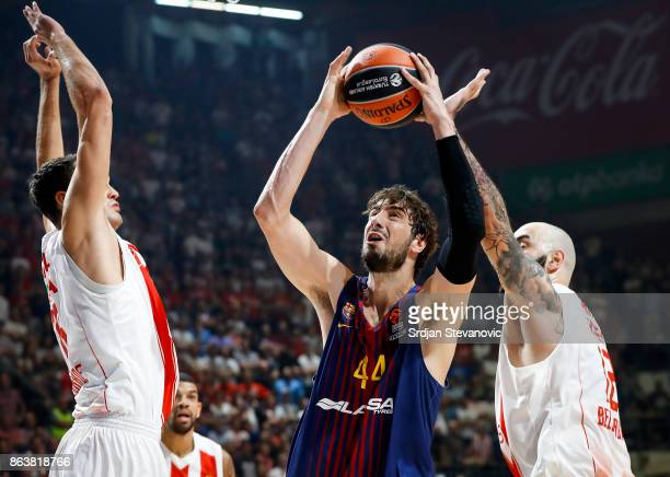 Ante Tomic of Barcelona in action against Stefan Jankovic and Pero Antic of Crvena Zvezda during the 2017/2018 Turkish Airlines EuroLeague Regular...