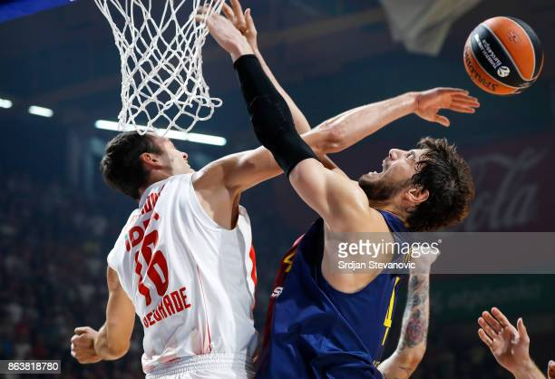 Ante Tomic of Barcelona is blocked by Stefan Jankovic of Crvena Zvezda during the 2017/2018 Turkish Airlines EuroLeague Regular Season game between...