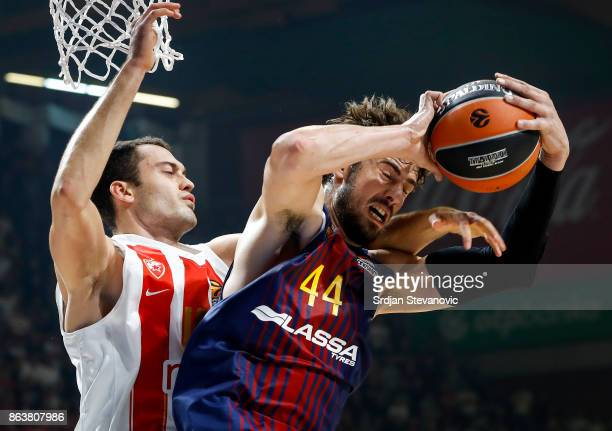 Ante Tomic of Barcelona is challenged by Stefan Jankovic of Crvena Zvezda during the 2017/2018 Turkish Airlines EuroLeague Regular Season game...