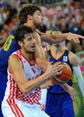 Ante Tomic of Croatia vies with Viacheslav Kravtsov of Ukraine during the FIBA Eurobasket quarter final match between Croatia and Ukraine at the...