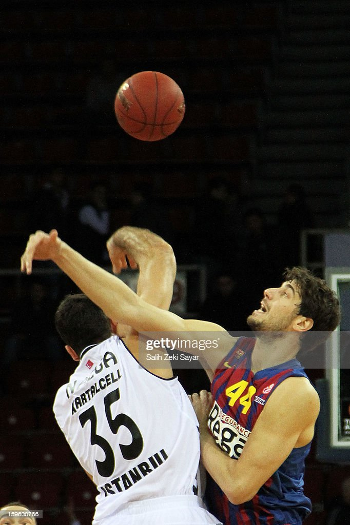 Ante Tomic #44 of FC Barcelona Regal and Cemal Nalga #35 of Besiktas JK Istanbul competes for the first ball of the 2012-2013 Turkish Airlines Euroleague Top 16 Date 4 between Besiktas JK Istanbul v FC Barcelona Regal at Abdi Ipekci Sports Arena on January 17, 2013 in Istanbul, Turkey.