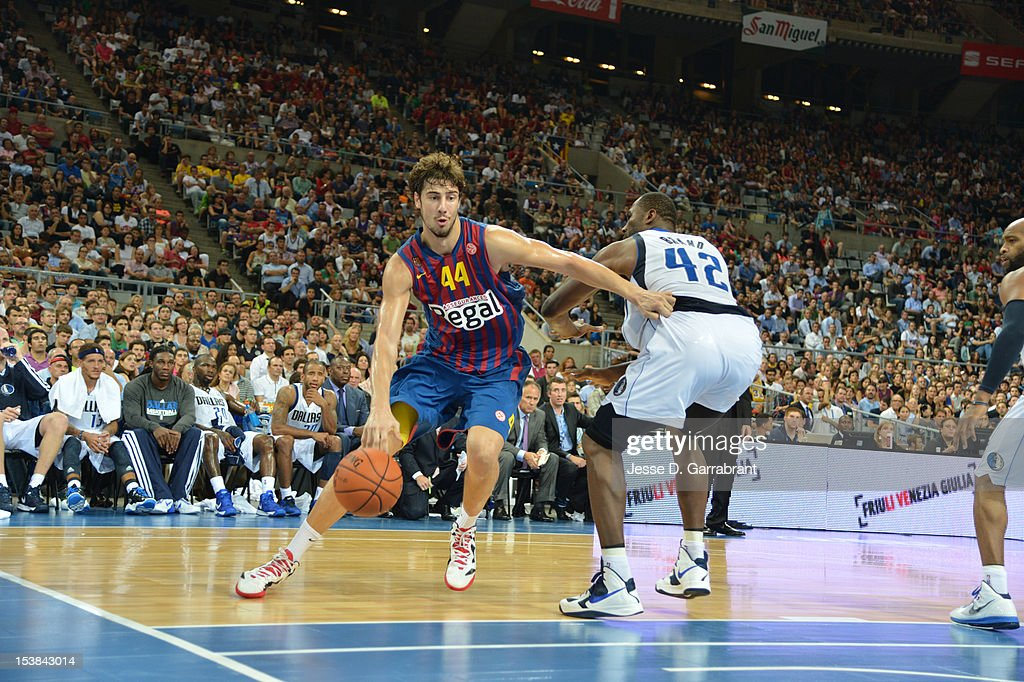 Ante Tomic #44 of F.C. Barcelona Regal drives against <a gi-track='captionPersonalityLinkClicked' href=/galleries/search?phrase=Elton+Brand&family=editorial&specificpeople=201501 ng-click='$event.stopPropagation()'>Elton Brand</a> #42 of the Dallas Mavericks during the game at Palau St. Jordi for NBA Europe Live 2012 on October 9, 2012 in Barcelona, Spain.