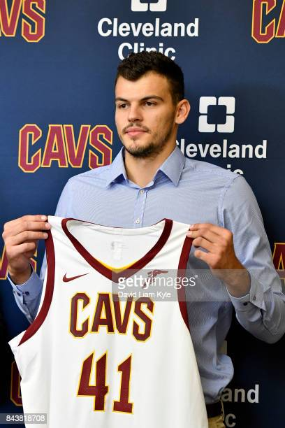Ante Zizic of the Cleveland Cavaliers shows of his new jersey as he is introduced to the media at The Cleveland Clinic Courts on September 7 2016 in...