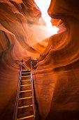 Beautiful view of amazing sandstone formations with a ladder leading toward a magic light beam in famous Antelope Canyon near the historic town of Page at Lake Powell, American Southwest, Arizona, USA