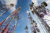 Telecommunication mast TV antennas wireless technology with blue sky
