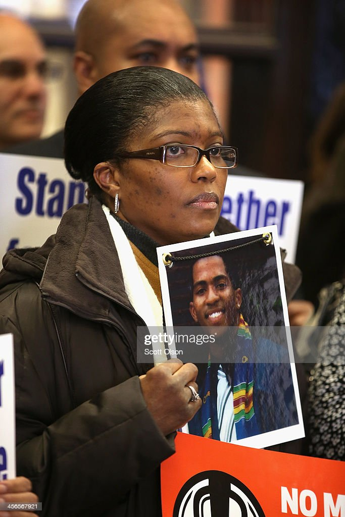 Anthanette Marshbanks holds a picture of her son Archie Lee Chambers Jr., 20, during a gathering of gun violence victims and gun control advocates at Cornell Square Park on the anniversary of the Sandy Hook Elementary School shooting December 14, 2013 in Chicago, Illinois. Thirteen people, including a three-year-old boy, were wounded when gunmen opened fire on a crowd gathered at the basketball courts in Cornell Square Park in September. Twenty children and 6 adults were killed when a gunman opened fire at Sandy Hook School.Chambers was shot and killed on April 21, 2012. He is one of nearly 1000 people that have been murdered in Chicago in the past two years, most by gunfire.