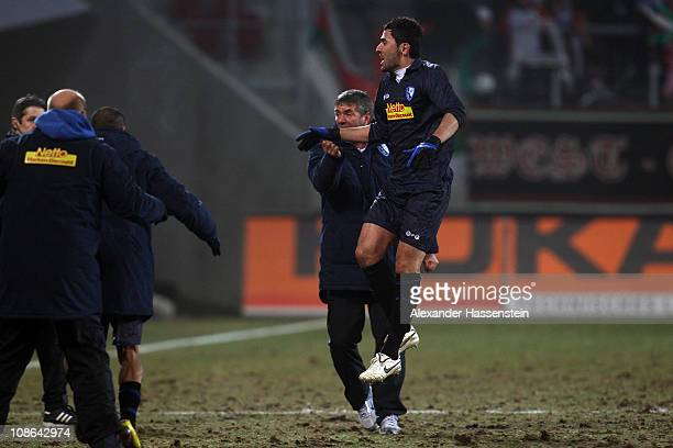 Anthar Yahia of Bochum celebrates the first team goal with his head coach Friedhelm Funkel during the Second Bundesliga match between FC Augsburg and...