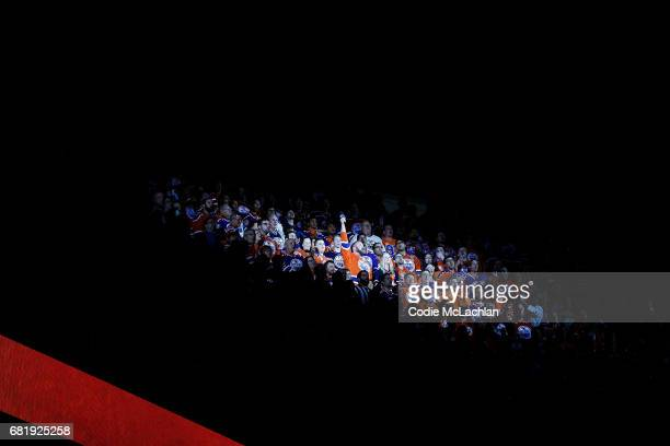 Anthem singer Robert Clark leads the audience in the singing of the Canadian and United States' national anthems as the Edmonton Oilers take on the...