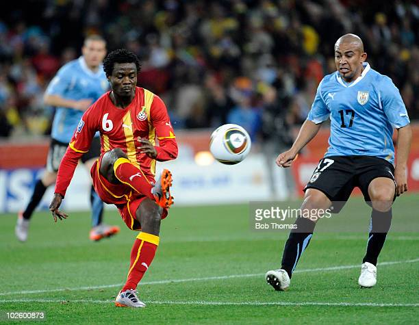 Anthong Annan of Ghana in action against Edigio Arevalo of Uruguay during the 2010 FIFA World Cup South Africa Quarter Final match between Uruguay...