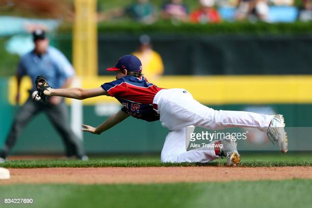 Anthony Abbonizio of the MidAtlantic team from New Jersey dives for a ground ball but can't make the play during Game 2 of the 2017 Little League...