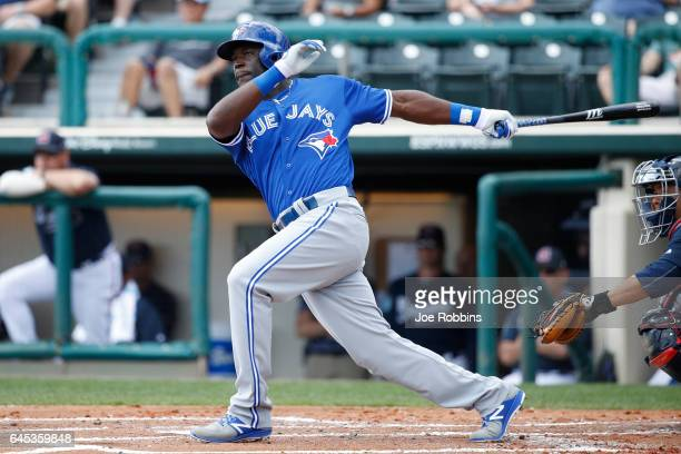 Anthony Alford of the Toronto Blue Jays doubles in a run against the Atlanta Braves in the second inning during the spring training game at Champion...