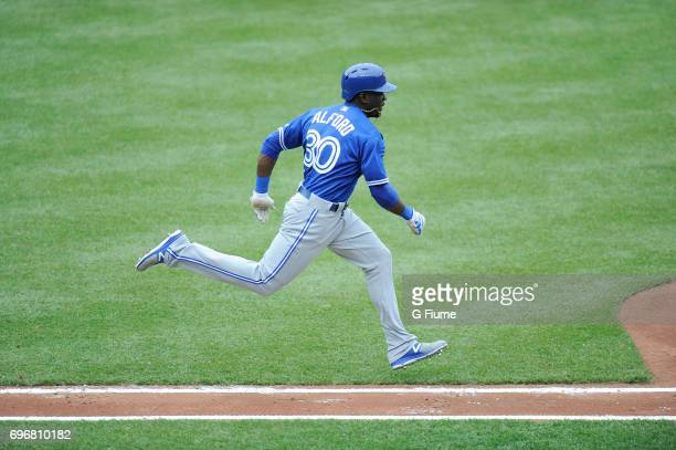 Anthony Alford of the Toronto Blue Jays runs towards first base against the Baltimore Orioles at Oriole Park at Camden Yards on May 21 2017 in...