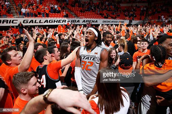 Anthony Allen Jr #32 of the Oklahoma State Cowboys celebrates with fans after the game against the Kansas Jayhawks at GallagherIba Arena on February...