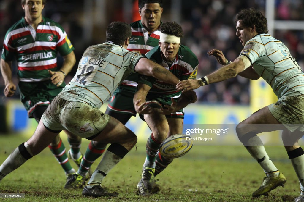 <a gi-track='captionPersonalityLinkClicked' href=/galleries/search?phrase=Anthony+Allen&family=editorial&specificpeople=542876 ng-click='$event.stopPropagation()'>Anthony Allen</a> of Leicester drops the ball as James Downey tackles during the Aviva Premiership match between Leicester Tigers and Northampton Saints at Welford Road on January 8, 2011 in Leicester, England.