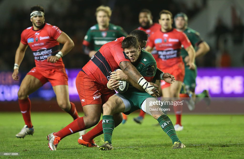 Anthony Allen of Leicester is tackled by Mathieu Bastareaud during the European Rugby Champions Cup pool three match between RC Toulon and Leicester Tigers at Felix Mayol Stadium on December 13, 2014 in Toulon, France.