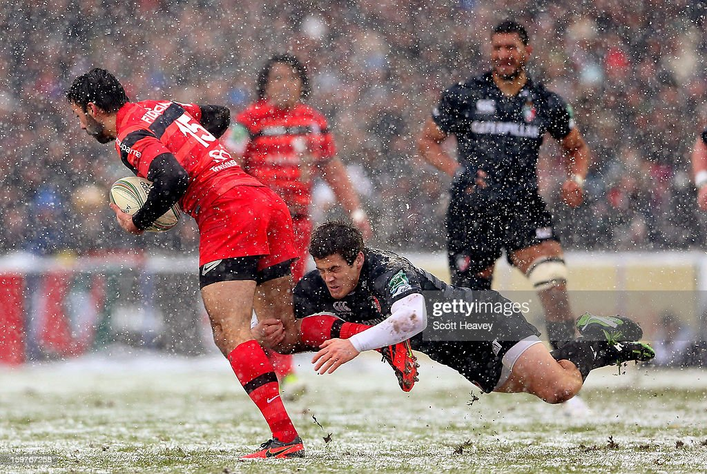 Anthony Allen of Leicester (R) tackles Clement Poitrenaud of Toulouse during the Heineken Cup match between Leicester Tigers and Toulouse at Welford Road on January 20, 2013 in Leicester, England.