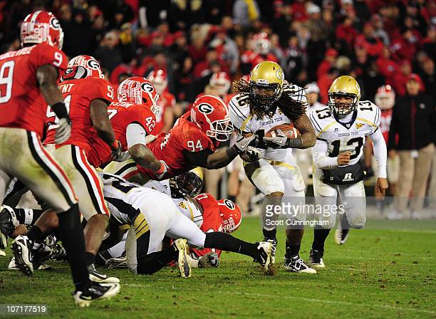 Anthony Allen of the Georgia Tech Yellow Jackets carries the ball against DeAngelo Tyson of the Georgia Bulldogs at Sanford Stadium on November 27...