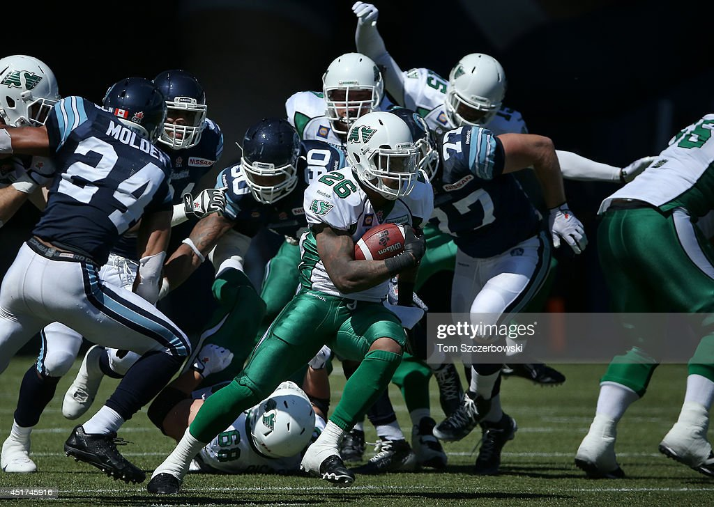 <a gi-track='captionPersonalityLinkClicked' href=/galleries/search?phrase=Anthony+Allen&family=editorial&specificpeople=542876 ng-click='$event.stopPropagation()'>Anthony Allen</a> #26 of the Saskatchewan Roughriders carries the ball during a CFL game against the Toronto Argonauts on July 5, 2014 at Rogers Centre in Toronto, Ontario, Canada.