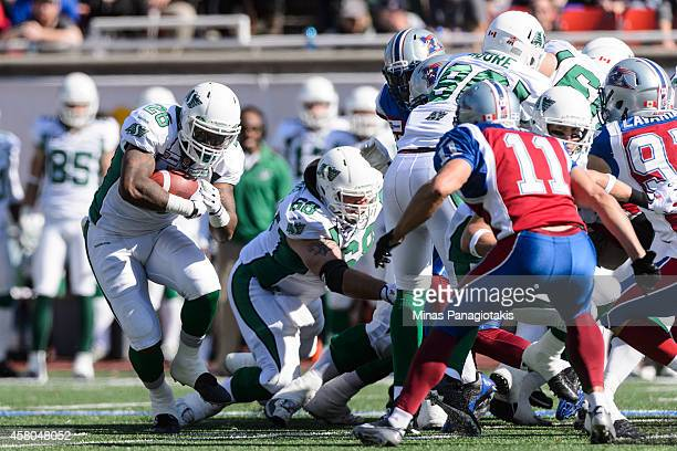 Anthony Allen of the Saskatchewan Roughriders carries the ball during the CFL game against the Montreal Alouettes at Percival Molson Stadium on...